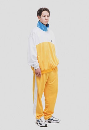 WKNDRS위캔더스 WKNDRS TRACK PANTS (YELLOW)