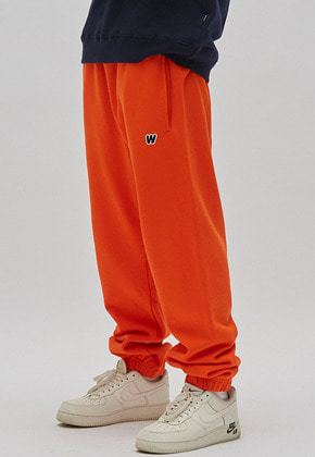 WKNDRS위캔더스 W LOGO SWEAT PANTS (ORANGE)